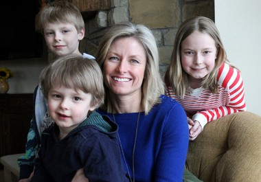 Lisa Buescher with her children Beckett, 3, Lance, 8, and Anna, 11 at their Moreland Hills home on Thursday. Buescher, an adoptee and board member for Adoption Network Ohio, hopes legislators will change Ohio law so she can obtain her original birth certificate and medical records that might be of help to her children in the future.