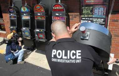 Law enforcement officials raid Players, an internet cafe, Wednesday in Euclid. Six cafes in Northeast Ohio were raided with machines confiscated and assets seized.