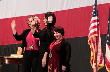 Amanda Berry, left, Gina DeJesus, center and Michelle Knight waive to the crowd at the State of the State address Monday after Gov. John Kasich presented them with the 2014 Ohio Courage medals.