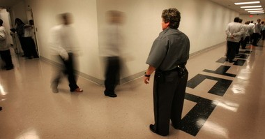 A guard at the Cuyahoga Hills Juvenile Correctional Facility in Highland Hills keeps watch as inmates go to class in this 2006 photo. Cuyahoga Hills is one of three remaining youth detention facilities operated by the state.