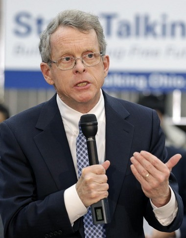 Ohio Attorney General Mike DeWine speaks at West Carrollton Middle School in a January 2014 file photo. On Thursday, DeWine announced a permanent ban on two chemical compounds often sprayed on plant material to mimic the effect of marijuana.