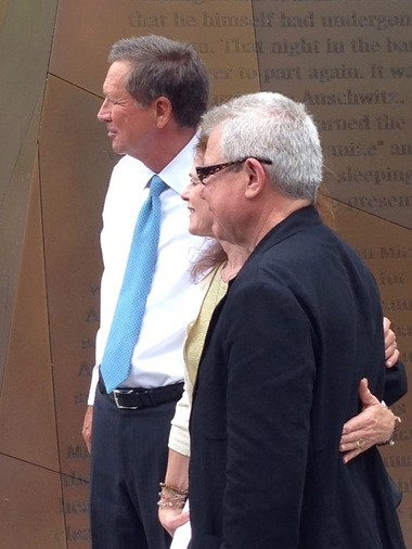 Ohio Gov. John Kasich, left, and sculptor Daniel Libeskind posed for pictures with visitors to the new Ohio Holocaust and Liberators Memorial following a dedication ceremony Monday.