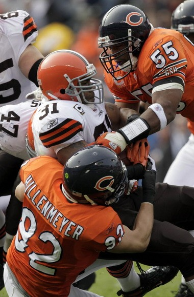 """The city of Cleveland is expected to lose millions of dollars in lost revenue and tax refunds after two former pro football players, including ex-Chicago Bears linebacker Hunter Hillenmeyer (#92), successfully challenged the city's """"jock tax"""" on visiting athletes."""