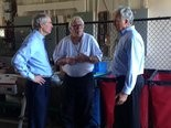 U.S. Sen. Rob Portman (left) chats with William Kile (center) and RIchard Trickel (right) during a Monday tour of the City Mission in Cleveland.