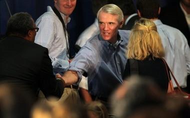 U.S. Sen. Rob Portman, shown here shaking hands at a rally for Gov. John Kasich in September.