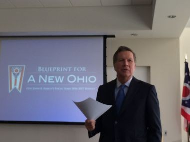 Gov. John Kasich proposed cutting taxes for some Ohio small businesses while increasing taxes on larger businesses as part of the income tax cut package he announced on Monday.