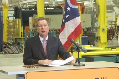 Ohio Gov. John Kasich signed a transportation budget bill Wednesday that will pump nearly $6 billion into state highway projects, send another $600 million to local governments for road and bridge work and bolster driver training and testing.