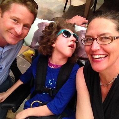 Chad, Lucy, and Nicole Scholten attend a performance of the Lion King. Lucy, 11, suffers from cerebral palsy and can have more than 100 seizures a day. Her parents think Lucy would benefit from medical marijuana.