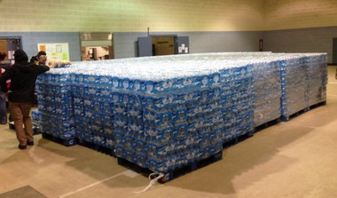 Pallets of water, ready for distribution in the community, sit at the Sebring Community Center, Tuesday, Jan. 26, 2016 in Sebring, Ohio.