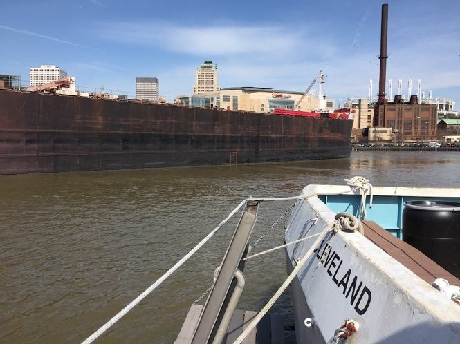 The Holiday, a 65-foot, steel-hulled boat owned by Bratton's company, is docked in the Cuyahoga River near the West Bank of The Flats.