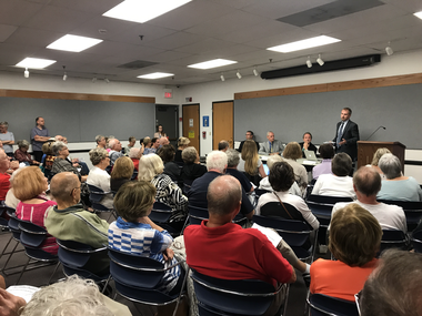 A crowd of around 100 packed the Bay Village branch of the Cuyahoga County Public Library on Tuesday, Sept. 19, 2017, for a forum on Issue 2.