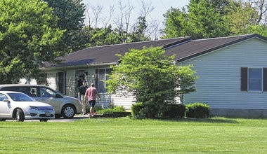 """Former Ohio House Speaker Cliff Rosenberger arrives at his Clarksville, Ohio home where he is greeted by an FBI agent Wednesday, May 23, 2018. An FBI spokesman confirmed Wednesday, that the agency was """"conducting law enforcement activities"""" in the area. Rosenberger resigned from the House last month after saying he was aware the FBI was asking questions about his activities and that he'd hired criminal defense attorney David Axelrod (John Hamilton/Wilmington News Journal via AP)"""