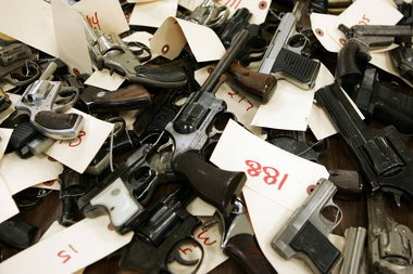 A collection of guns turned in during one of Cleveland Police Department's gun buybacks. New legislation would prohibit law enforcement agencies in the state to melt down or destroy the weapons.