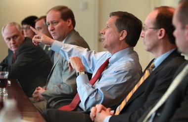 Gov. John Kasich with members of his Cabinet. To the right of the governor is Greg Moody, director of the GovernorâÂÂs Office of Health Transformation.