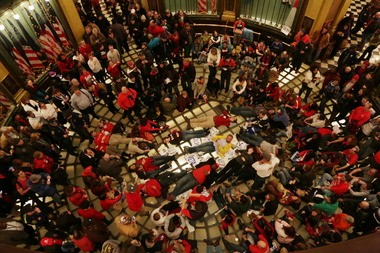 A crowd of protestors inside the Capitol in Lansing, Mich., demonstrate against two controversial right-to-work bills that passed a lame-duck Michigan legislature in 2012 and were quickly signed into law by Gov. Rick Snyder.