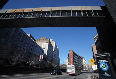 A skywalk spans Prospect Avenue, connecting a parking garage and a building that will be torn down to make way for the new Cuyahoga County government building.