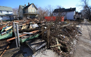 A pile of rubble was all that remained after a home on West 32nd Street in Cleveland was demolished on Feb. 9, 2012.