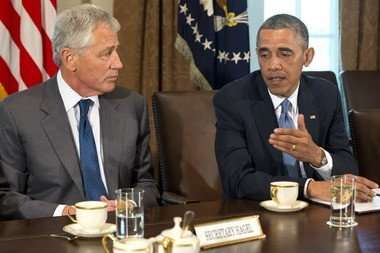 President Barack Obama gestures to Defense Secretary Chuck Hagel while making a statement during a May 16 White House meeting on sexual assault in the military. Also attending were Joint Chiefs of Staff Chairman Gen. Martin Dempsey, the service secretaries, service chiefs, and senior enlisted advisers.
