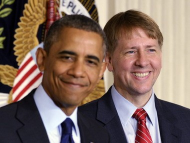 President Barack Obama and Richard Cordray, right, after the Senate confirmed Cordray as the director of the Consumer Financial Protection Bureau in 2013. He served as a temporary appointee before confirmation.