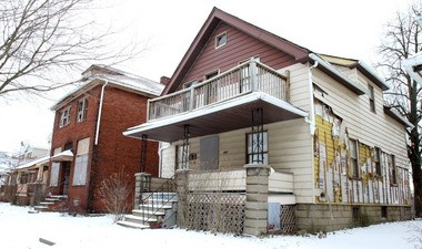 A row of abandoned houses on East 144th Street in Cleveland, photographed in February. Cleveland Reserve Bank President Sandra Pianalto writes that restoring property values will involve a lot more than simply demolishing or rehabbing blighted properties, requiring strategic investments in Cleveland and its neighborhoods.