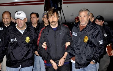 A Nov. 16, 2010, file photo provided by the Drug Enforcement Administration shows Russian arms trafficking suspect Viktor Bout, center, in U.S. custody after being flown from Bangkok to New York in a chartered U.S. plane. He was later convicted of selling arms to a Columbian terrorist group and sentenced to 25 years in prison. Bout reportedly used a dozen U.S. shell companies as part of his arms dealings.