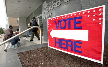 Voters head into the front door of the Cuyahoga County Board of Elections office on the day before Election Day to vote early in November 2010. The Voters Bill of Rights, a proposed constitutional amendment, would set early voting times in the Ohio Constitution.