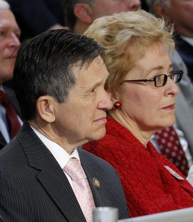 In this Sept. 20, 2011, file photo, then-U.S. Congressman Dennis Kucinich and U.S. Congresswoman Marcy Kaptur sit side-by-side as Vice President Joe Biden visits a small manufacturing business in Solon. A Republican-drawn congressional district map in Ohio pitted the two veteran Democratic politicians against one another in a not-very-friendly 2012 primary battle that Kaptur won.