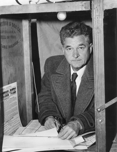 Democratic Gov. Frank J. Lausche, in a voting booth in Cleveland on Nov. 1, 1956. In 1949, Ohio Republicans had pushed through a change in the state's straight-ticket voting law to avoid a defeat for GOP Sen. Bob Taft in 1950 if too many Ohio Republicans voted for the popular Lausche, who headed the Democratic ticket -- typifying successful GOP election-law strategy in Ohio, Thomas Suddes writes.