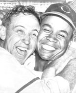 After the Cleveland Indians won Game 4 of the 1948 World Series, pitcher Steve Gromek and center fielder Larry Doby embraced, the first widely publicized photo of black and white baseball players hugging in the joy of victory.