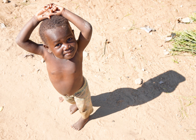 A boy in the Zambian village of Nakatindi, where average household income is about $100 a month but there is hope.