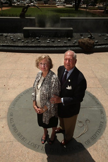 Larry and Barbara Catuzzi stand in Lauren's Garden in Market Square Park.