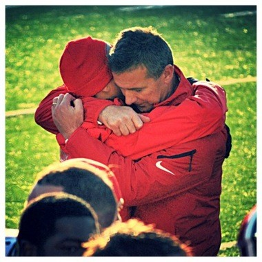 Urban Meyer hugs his son, Nate, on the sidelines after Ohio State clinches its win over Michigan last season. Meyer called it one of the best moments of his life.