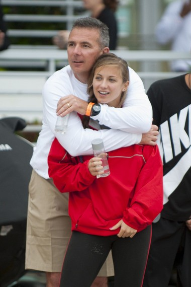 """Urban Meyer with his middle child, Gigi, who said her dad runs the Ohio State football team like a """"family business."""""""
