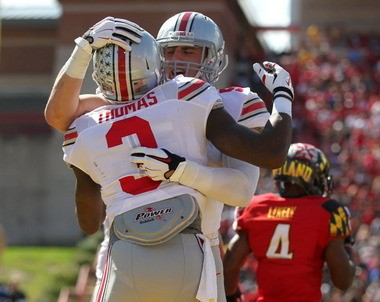 Ohio State wide receiver Michael Thomas celebrates his touchdown with teammate Jeff Heuerman in the second quarter of the Buckeyes' 52-24 win over Maryland.
