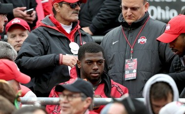 Ohio State Buckeyes quarterback J.T. Barrett (16) earlier was carted off the field and returned to watch the game in the stands in the fourth quarter against Michigan.