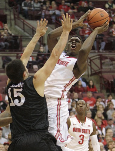 Ohio State's Jai'Sean Tate, right, shoots over High Point's Lorenzo Cugini during the second half of Wednesday night's game at Value City Arena.