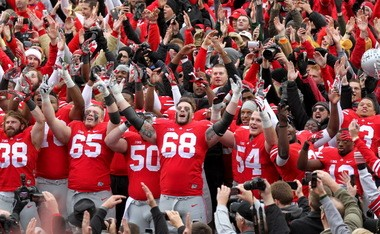 "Ohio State offensive lineman Taylor Decker (68) and teammates sing ""Carmen Ohio"" after beating Michigan."