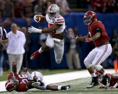 Ohio State Buckeyes running back Ezekiel Elliott (15) leaps over Alabama Crimson Tide defensive back Landon Collins (26) and past linebacker Ryan Anderson (7), right, in the first quarter of the Sugar Bowl.