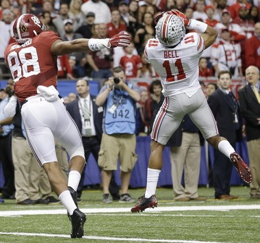 Ohio State defensive back Vonn Bell (11) intercepts a ball intended for Alabama tight end O.J. Howard (88) in the second half of the Sugar Bowl NCAA college football playoff semifinal game, Thursday, Jan. 1, 2015, in New Orleans.
