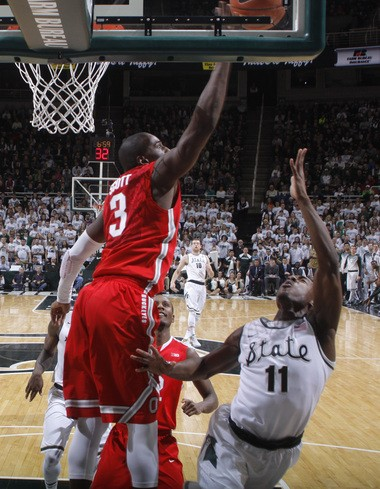Ohio State's Shannon Scott (3) blocks a shot by Michigan State's Lourawls Nairn Jr. (11) during the first half of the Spartans' 59-56 victory on Saturday in East Lansing.