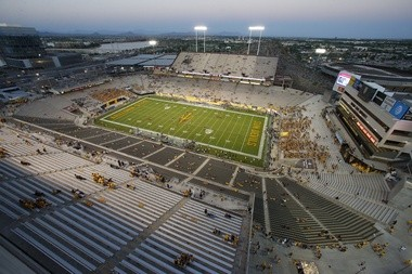 Some of the newly finished stadium construction, foreground, as Sun Devil Stadium starts to fill up with fans prior to a game against Northern Arizona on Sept. 3 in Tempe, Ariz.