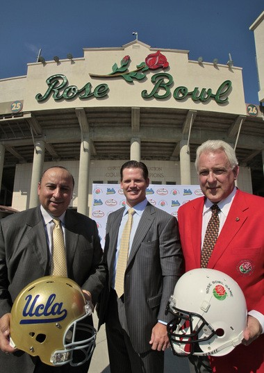Left to right, UCLA director of athletics Dan Guerrero, former All-American QB Cade McNown and Jeff Throop, Tournament of Roses president announce a $152 million renovation of the 100-year-old Rose Bowl in 2010. But is the Rose Bowl too far away from UCLA?