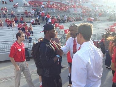 Jerome Baker being sandwiched by Gene Smith and Mark Pantoni during his Ohio State visit in September of 2014.