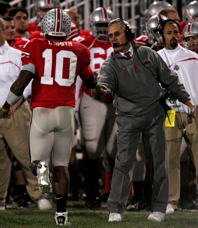 Troy Smith (10) and Jim Tressel celebrated a touchdown during the Buckeyes win over Michigan on Nov. 18, 2006.