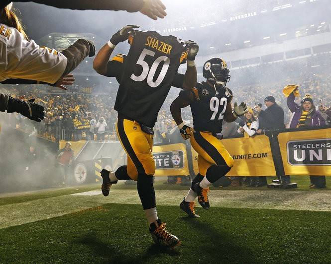 58460d153 Steelers defensive end Cameron Heyward takes the field holding the jersey  of teammate Ryan Shazier as he runs onto the field before Sunday's game vs.  the ...