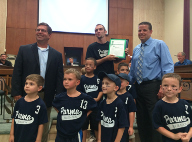Parma reisdent Jeffrey Trusnik was honored at the council meeting for being coach of the year.