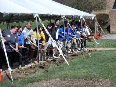 Members of the Ursuline College community break ground on Tuesday at the site of the new healing arts and science center. Ground was also broken on a new athletic center, which will be in close proximity to the new academic building.