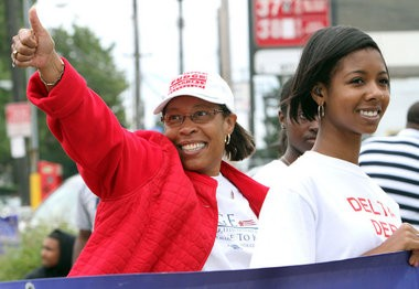 Congresswoman Marcia Fudge gives supporters a thumbs up as she worked the crowd at the 40th annual Eleventh Congressional District Community Caucus Labor Day Parade on Monday, September 5, 2011.