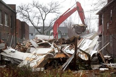 Convicted serial murderer Anthony Sowell's Imperial Avenue home in Cleveland,OH, is demolished, Tuesday, December 6, 2011. But fear in the wake of his slaughter remains strong in certain Cleveland communities. (Marvin Fong / The Plain Dealer)