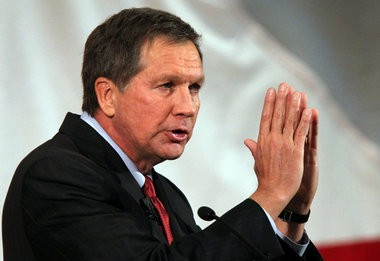 Ohio Governor John Kasich on Friday signed legislation freezing the state's laws requiring utilities to use renewable power and help customers use less electricity.